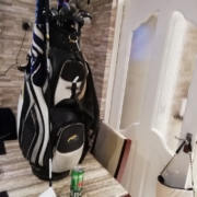 Golf bag on table with can of beer