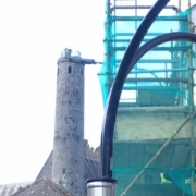 Tall round tower next to scaffolding